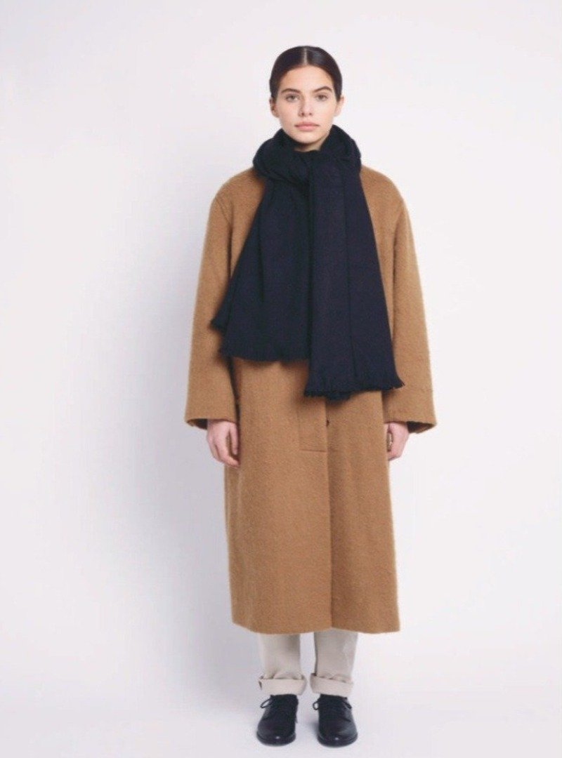 woman wearing a brown coat and a black single scarf alpaca loca sanna conscious concept