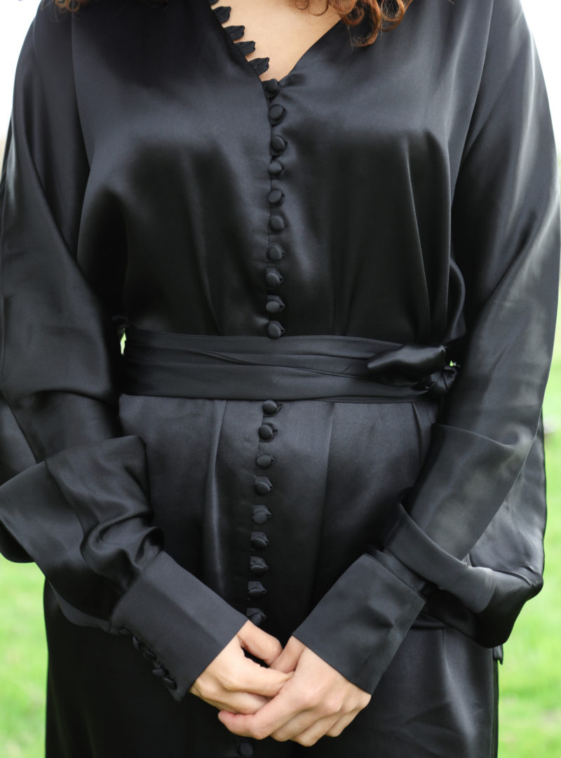 close-up on a black dress with buttons envelope1976 sanna conscious concept