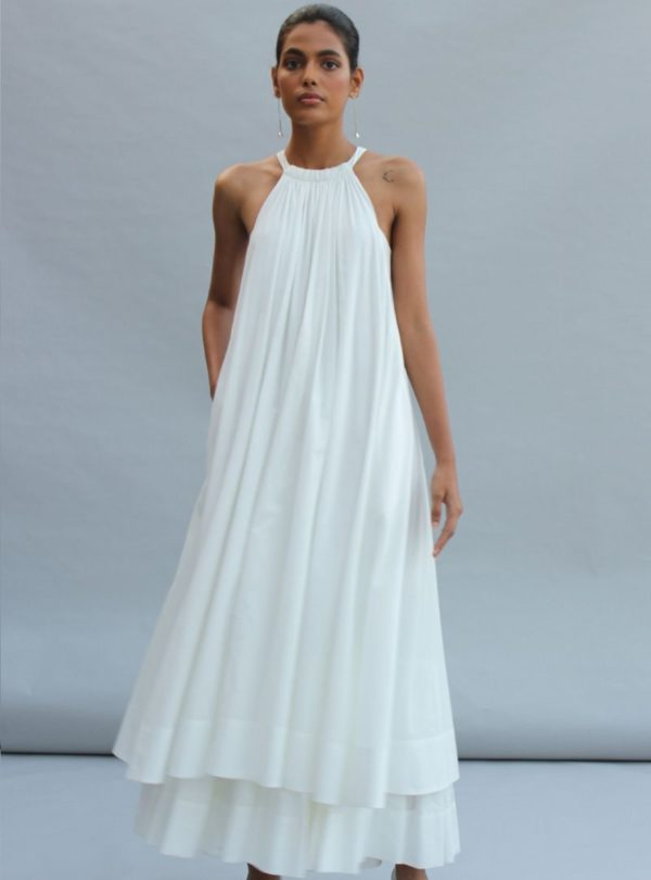 woman wearing a white dress abeer the summer house sanna conscious concept