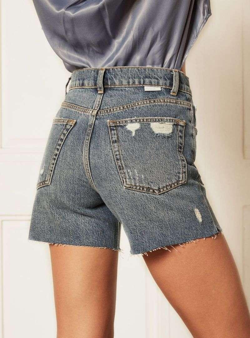 woman wearing blue short jeans denim back boyish jeans sanna conscious concept