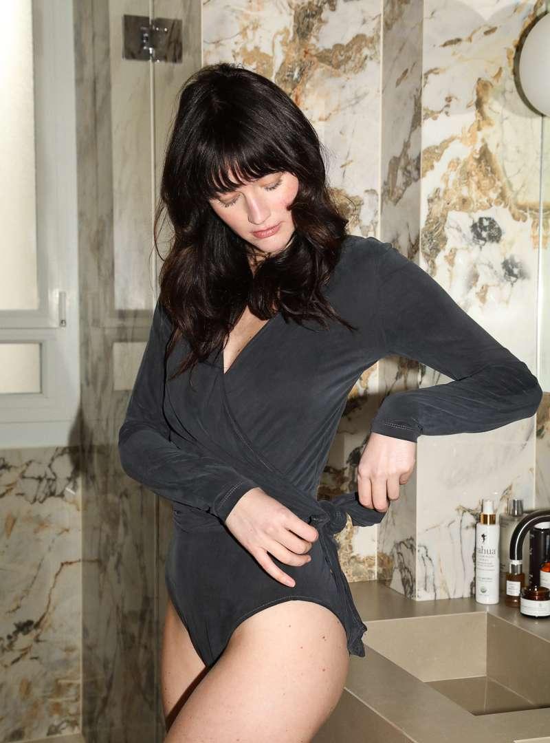 Woman Wearing Black Body Suit Sanna Conscious Concept