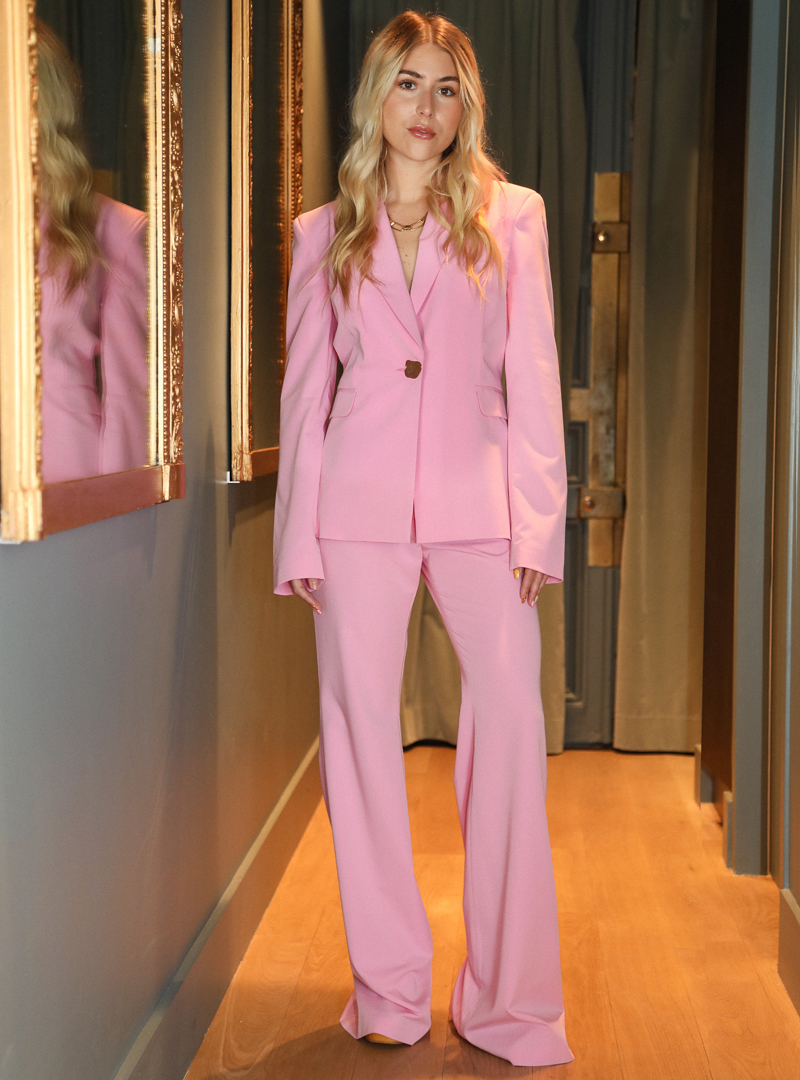 woman wearing pink blazer and a pink pant bogdar sanna conscious concept