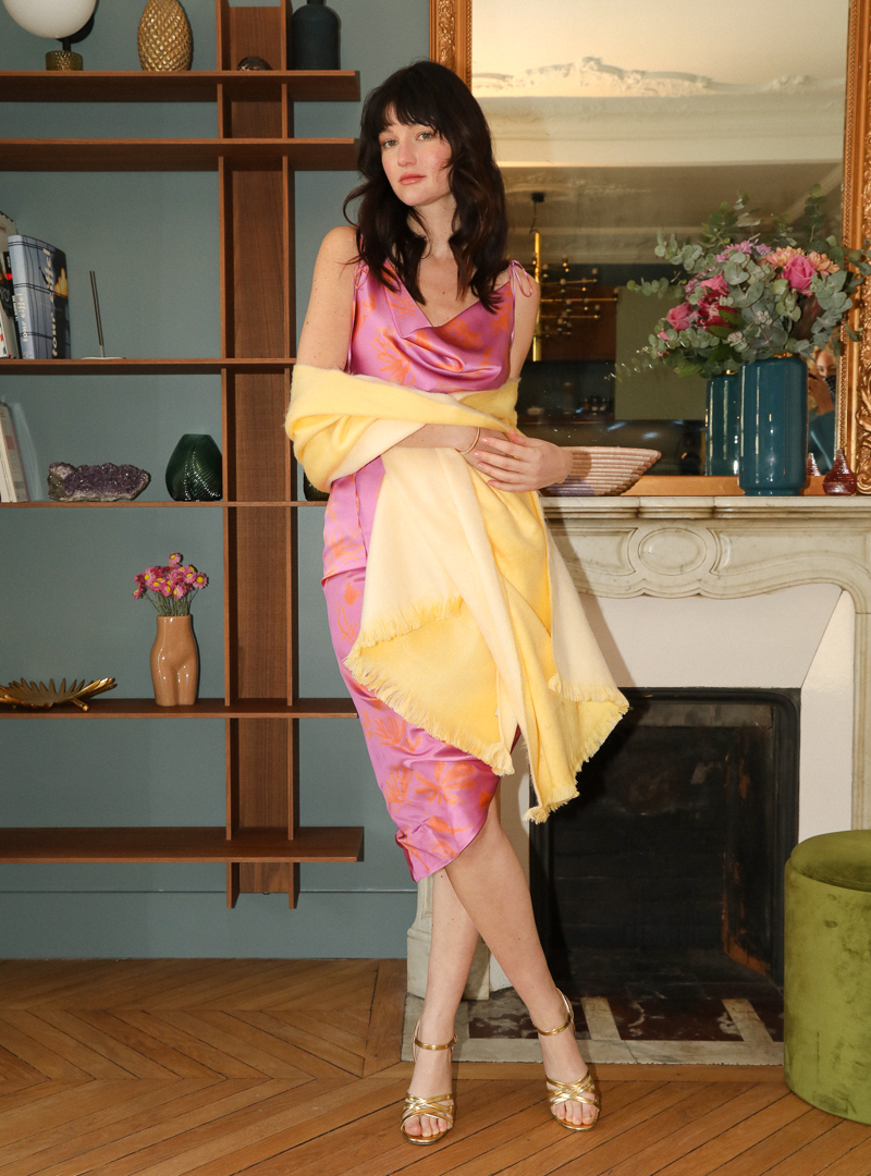 woman wearing pink dress in silk and a yellow scarf bogdar sanna conscious concept