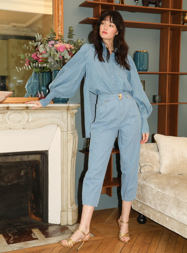 woman wearing blue denim outfit mother of pearl sanna conscious concept