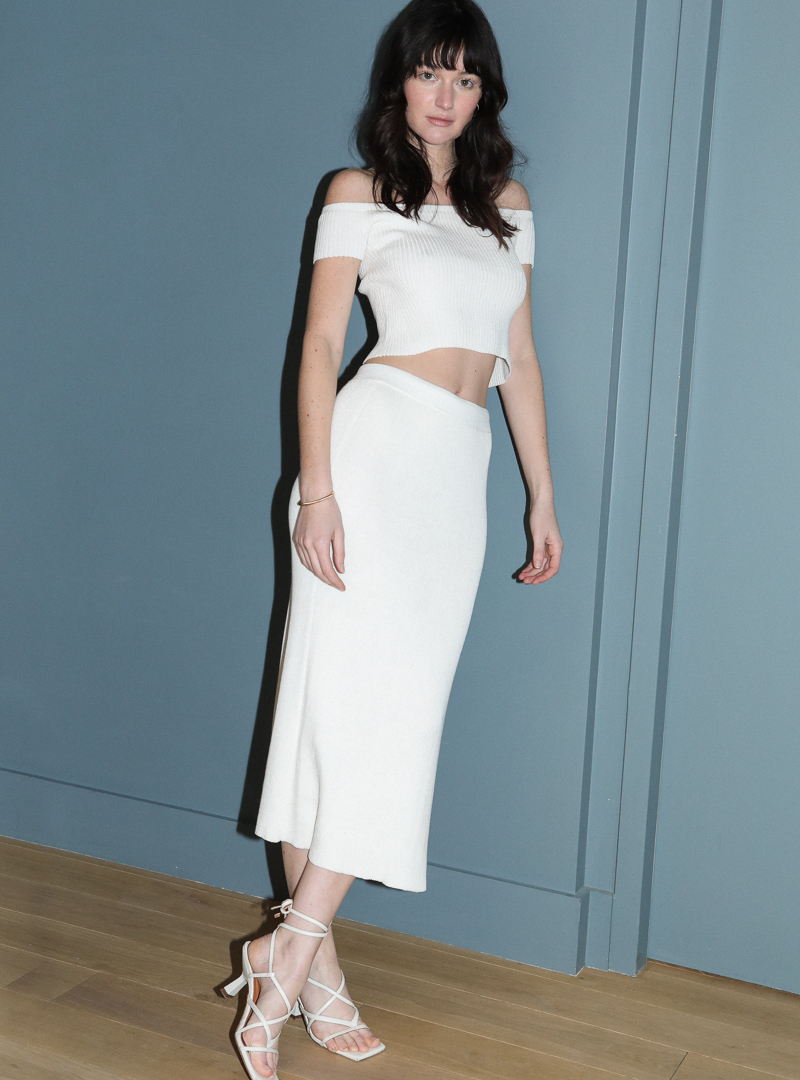 woman wearing a white top and a white skirt eleven six sanna conscious concept