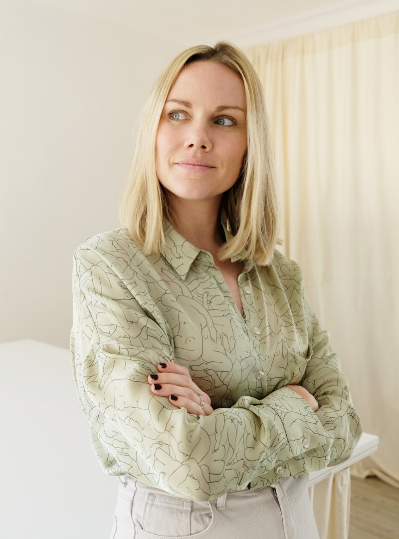 Blond Woman Wearing a Graphic Pale Green Shirt OhSevenDays Sanna Conscious Concept