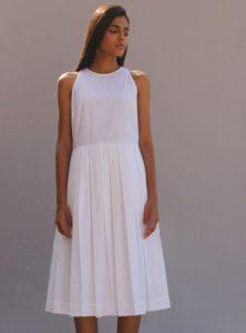 woman wearing a white midi dress stella the summer house sanna conscious concept