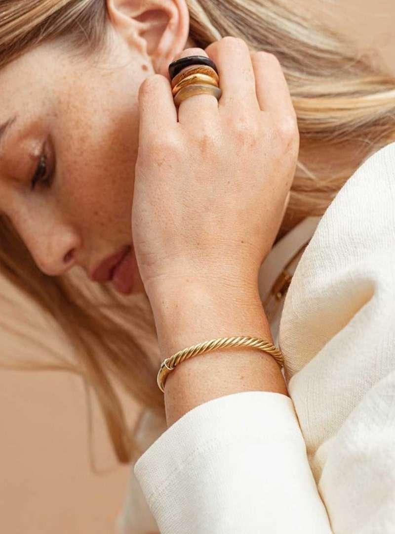 woman wearing the uzi cuff bracelet soko sanna conscious concept