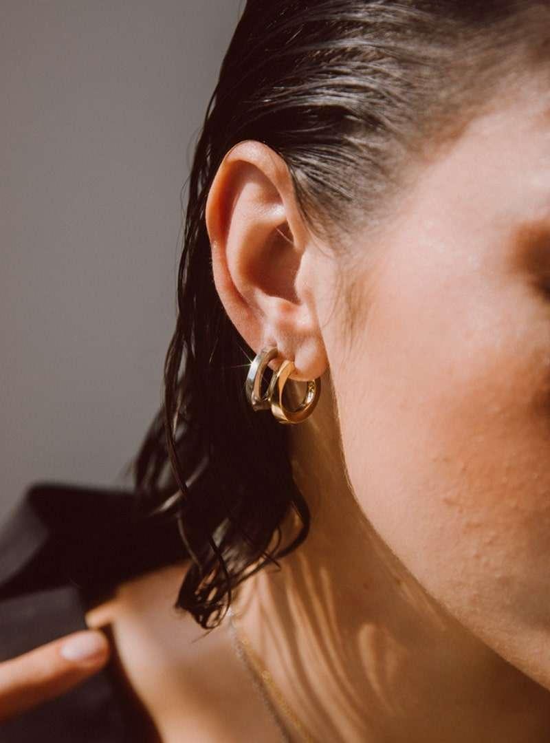 woman wearing the imara mini hoop earrings soko sanna conscious concept