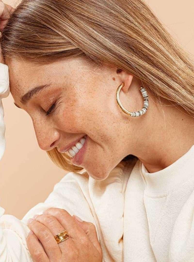 woman wearing the karamu horn hoop earrings soko sanna conscious concept