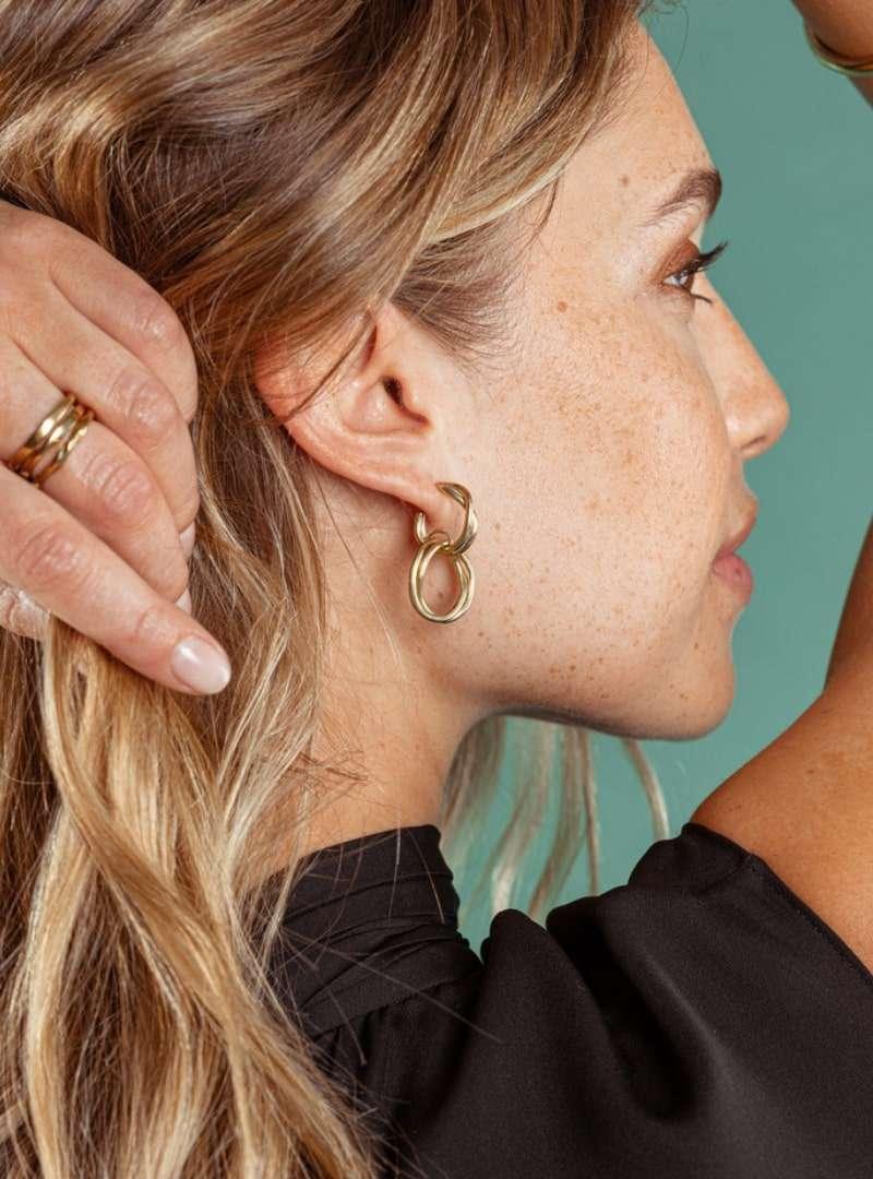 woman wearing the nia earrings soko sanna conscious concept