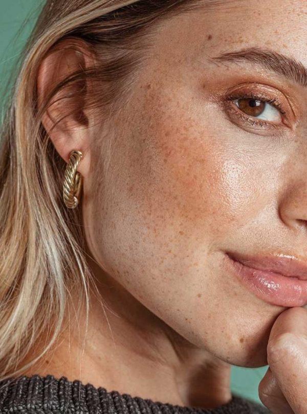 woman wearing the uzi mini hoop earrings soko sanna conscious concept