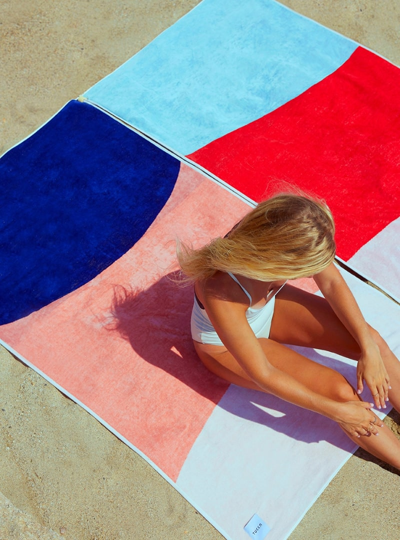 girl laying on tucca towel