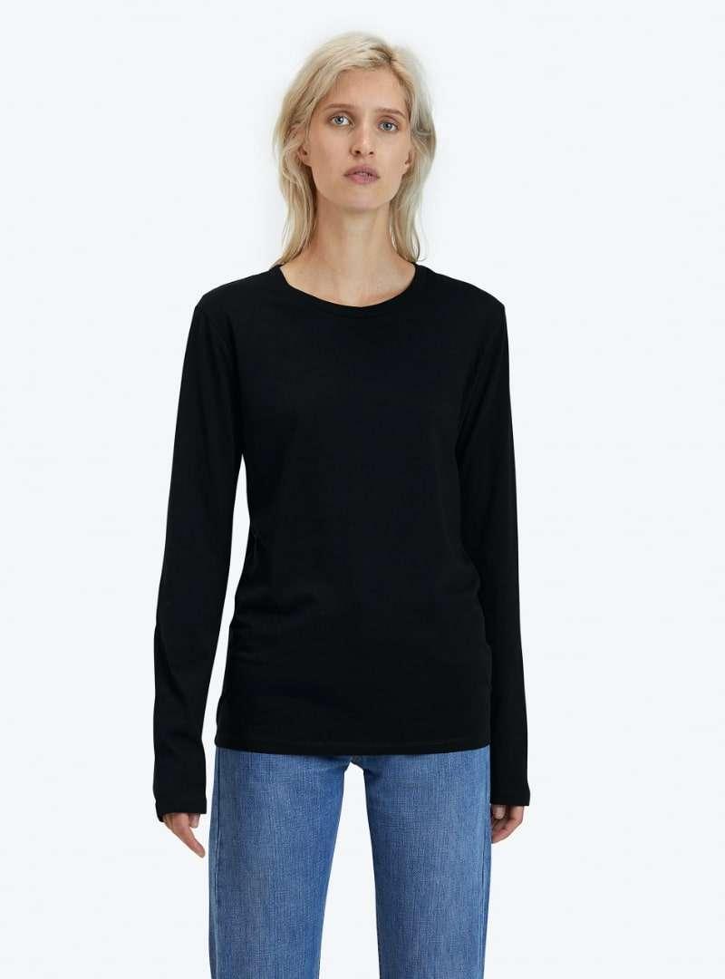 woman wearing long sleeve black shirt goat sanna conscious concept