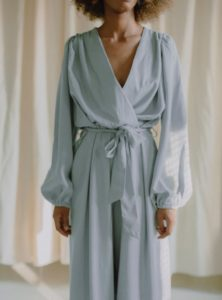 woman wearing a light blue jumpsuit from Cossac sanna conscious concept