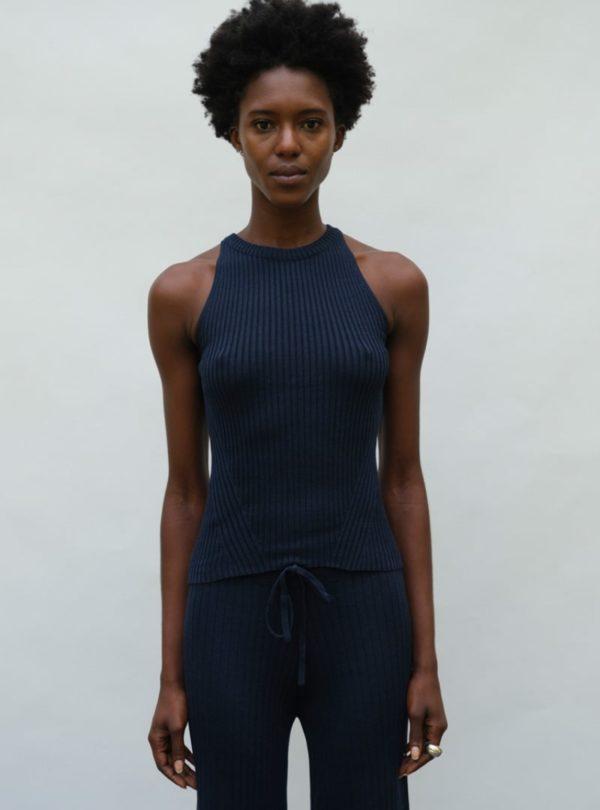 woman wearing a navy tank eleven six sanna conscious concept