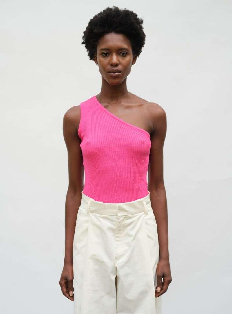 woman wearing a fuchsia tank eleven six sanna conscious concept