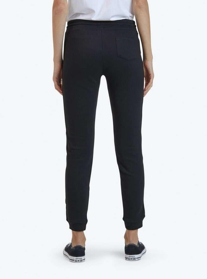 woman wearing black sweatpants goat sanna conscious concept