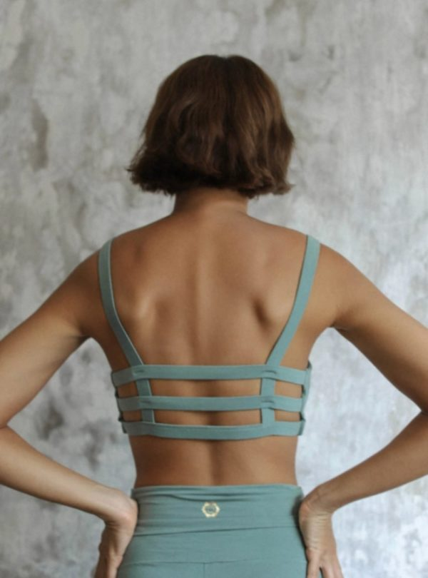 woman wearing boxy crop sport bra green sage indigo luna sanna conscious concept