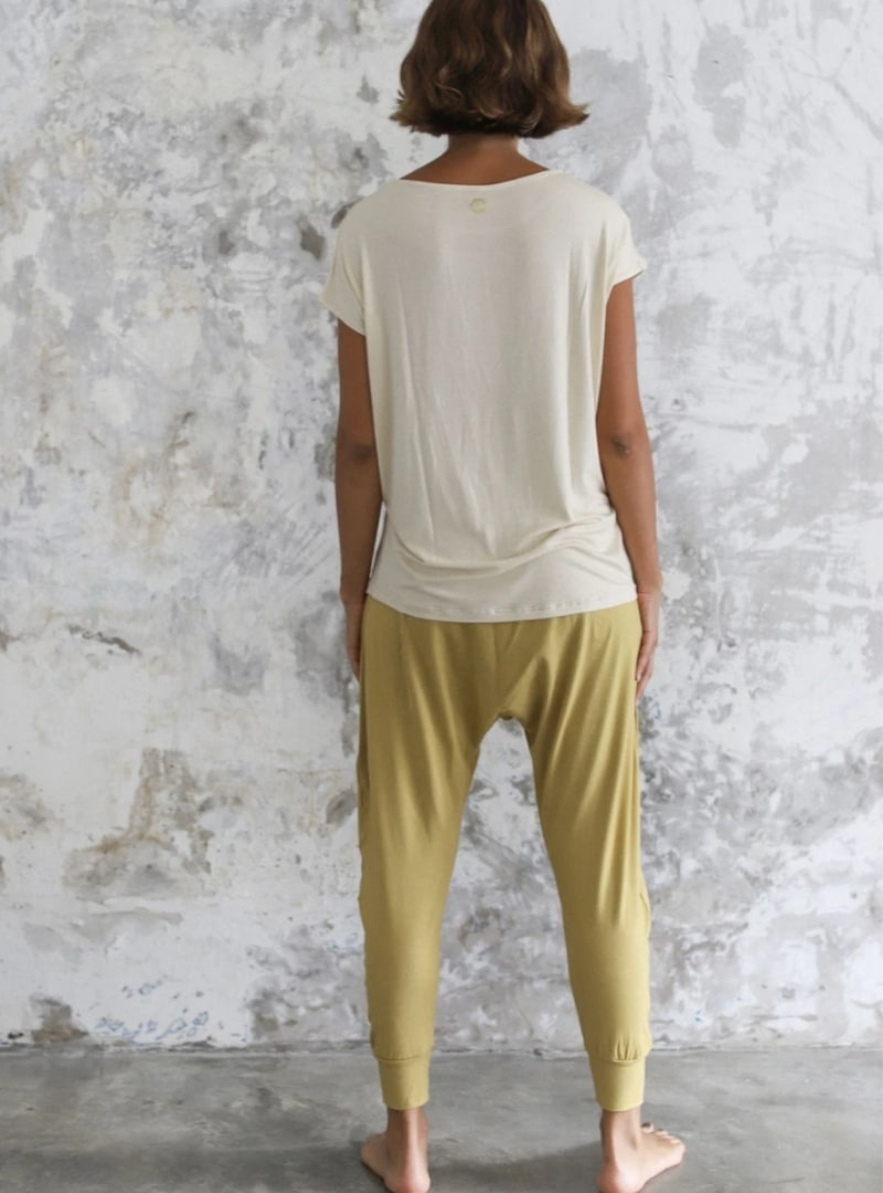 woman wearing beige t shirt indigo luna sanna conscious concept