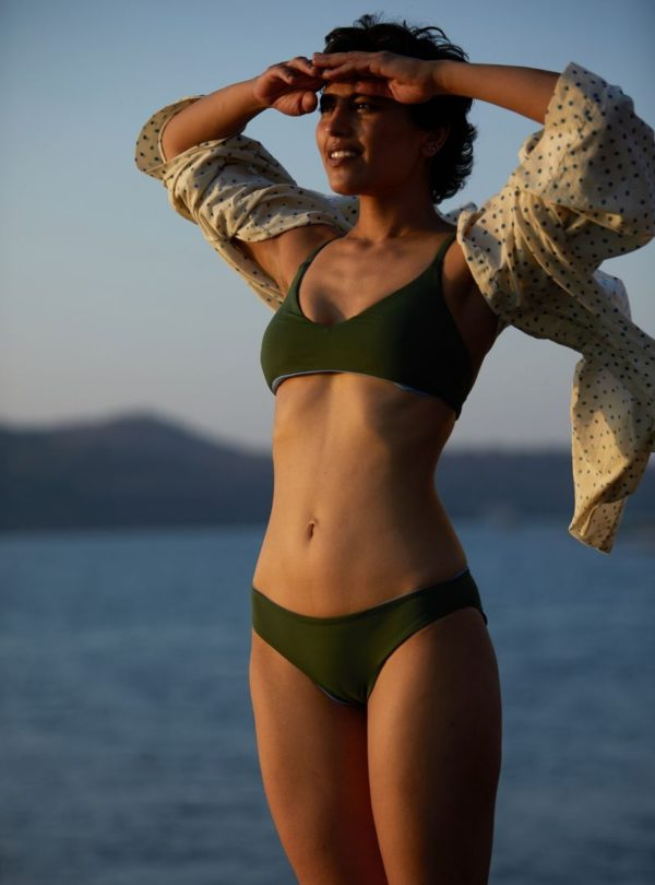 woman with herds on her front wearing a green bikini and a shirt the summer house sanna conscious concept