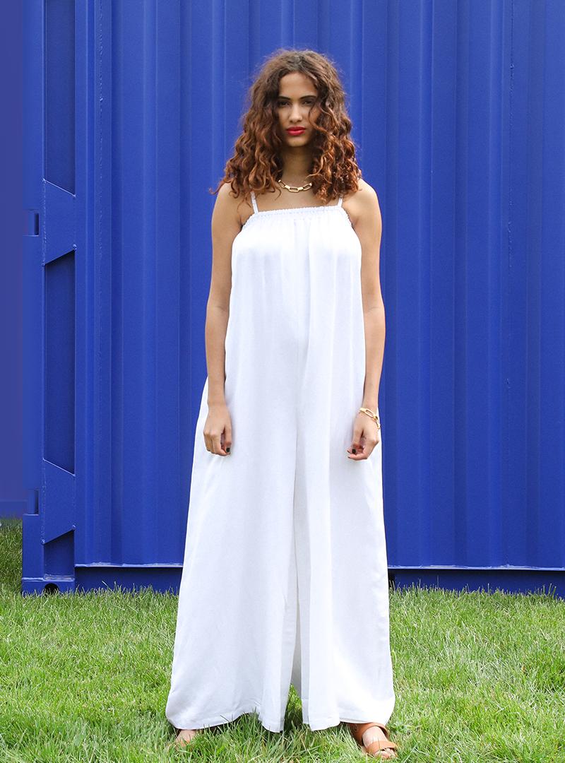woman wearing a white jumpsuit ohsevendays sanna conscious concept