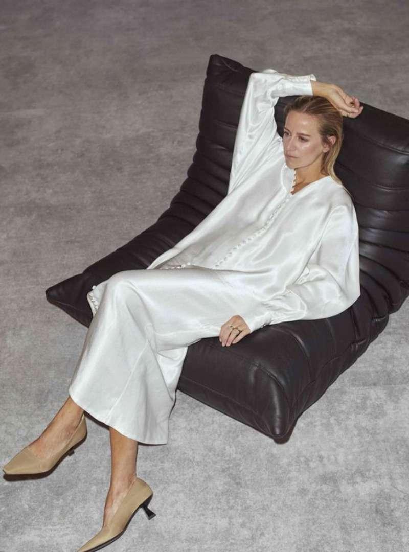 Woman Wearing Long White Satin Dress Sanna Conscious Concept