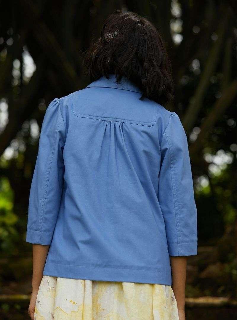 woman wearing a blue jacket the summer house sanna conscious concept