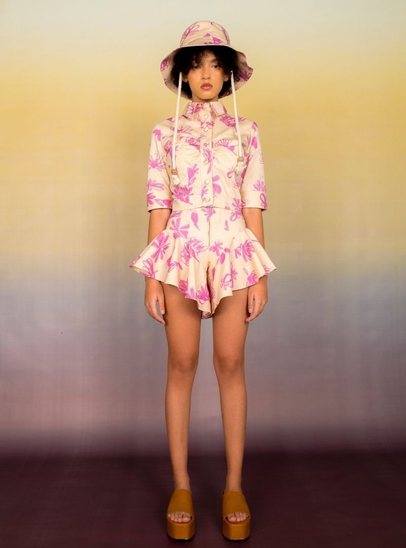 woman wearing a floral jacket and a shorts set in tan and pink bogdar sanna conscious concept