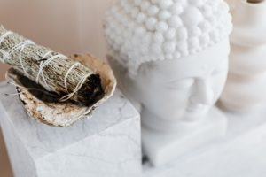 photo of sage baton next to a white figure for the archive about feng shui sanna conscious concept