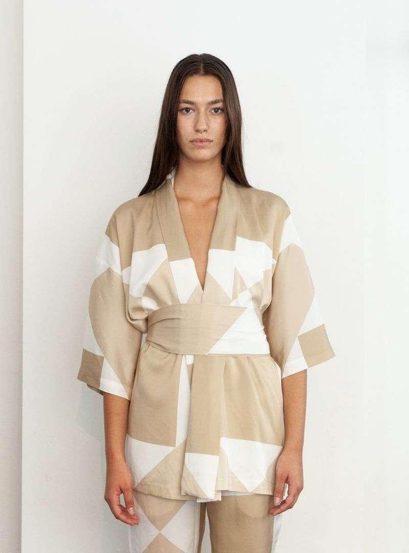 woman wearing tan kimono envelope 1976 sanna conscious concept