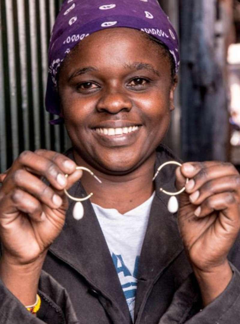 Woman Holding Hoop Earrings Soko Sanna Conscious Concept