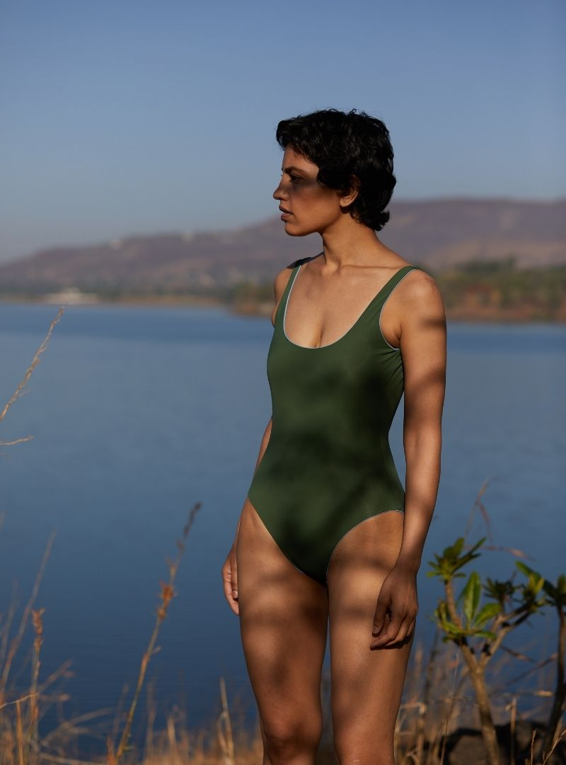 woman weariing a green one piece the summer house sanna conscious concept