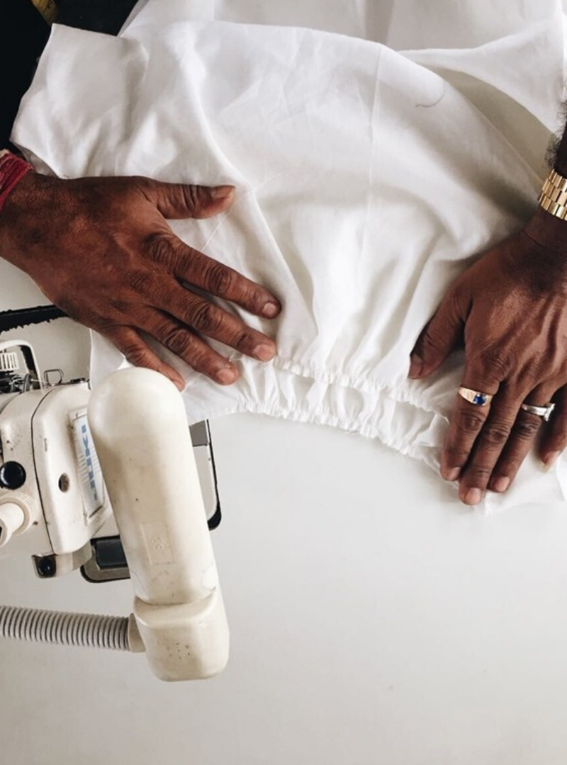 Woman Hands Sewing White Fabric The Summer House Sanna Conscious Concept