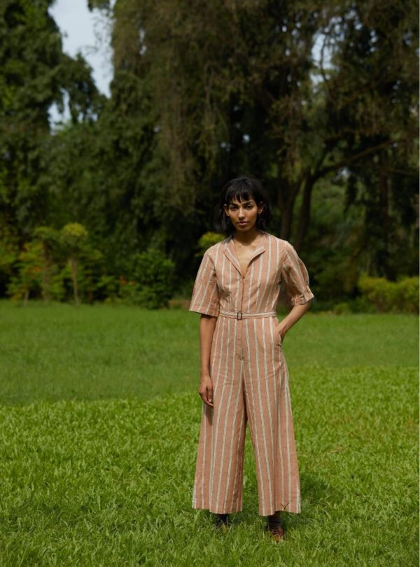 women wearing a brown jumpsuit with white stripes the summer house sanna conscious concept