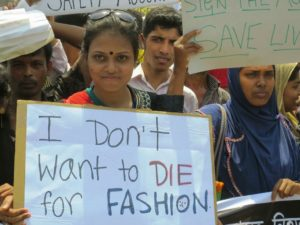 woman holding a sign i dont want to die for fashion archive unpacking the rana plaza collapse sanna conscious concept