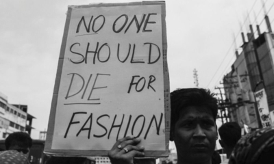 a man holding a sign saying no one should die for fashion archive on the collapse of the rana plaza sanna conscious concept