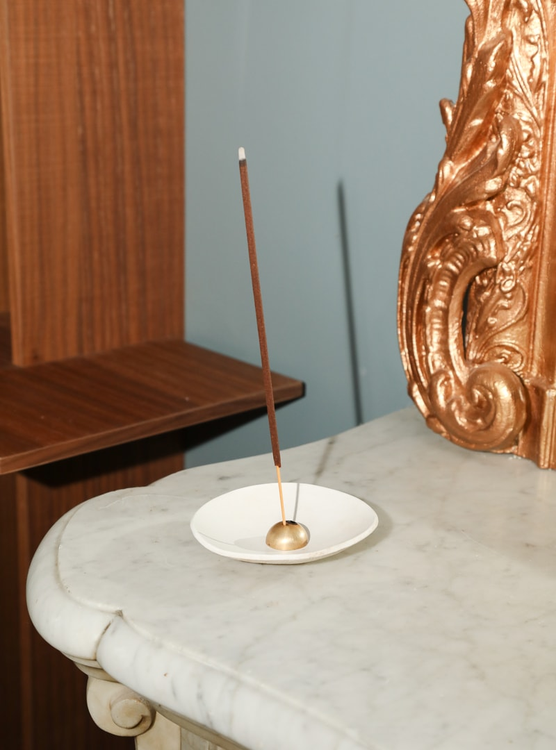 incense on a table archive on how to cleanse your space with incense sanna conscious concept