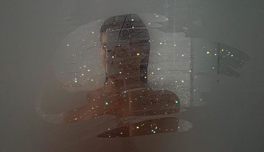 woman taking a picture in a glittery mirror archive about does our body odour change as we age sanna conscious concept