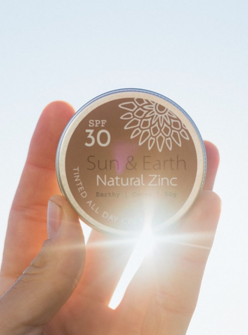 sun and earth logo sanna conscious concept