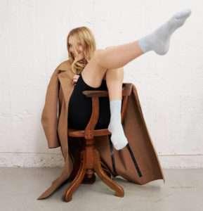 woman wearing grey glittery socks swedish stockings sanna conscious concept
