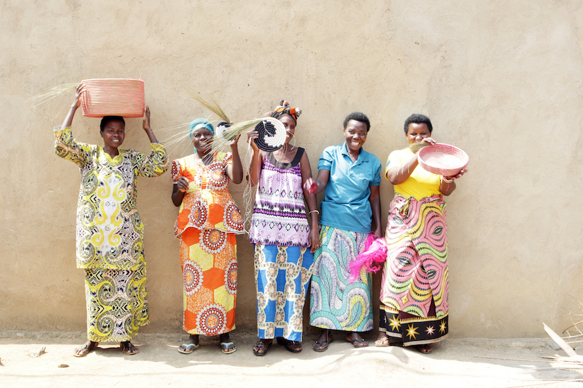 Women handcrafting in traditionnaIs outfits Indego Africa Sanna Conscious Concept